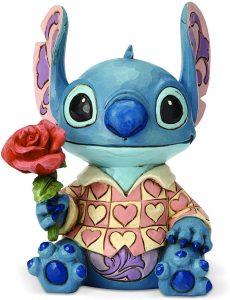 Figura y muñeco de Stitch con rosa de Enesco de Disney Traditions - Figuras coleccionables, juguetes y muñecos de Lilo y Stich - Muñecos de Disney