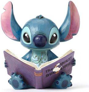 Figura y muñeco de Stitch leyendo de Enesco de Disney Traditions - Figuras coleccionables, juguetes y muñecos de Lilo y Stich - Muñecos de Disney